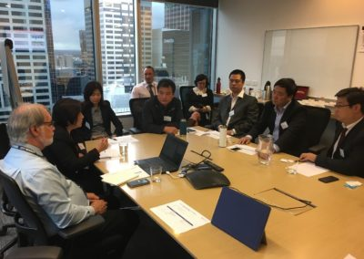 Bridging Translation's senior conference interpreter is helping a Chinese delegation with a conference at Australian Energy Market Operator
